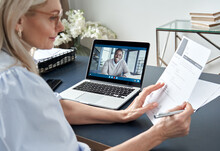 Female Hr Reading Cv During Online Virtual Job Interview By Video Call. Employer Checking African Male Recruit Resume Talking By Distance Remote Recruitment Chat Meeting Video Conference On Laptop.