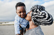 African mother kissing her son outdoor - Love and family concept - Love and family people concept - Main focus on woman eye
