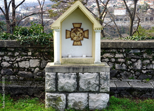 Photo Stations of the Cross or Way of the Cross, 5th station, Simon of Cyrene is made
