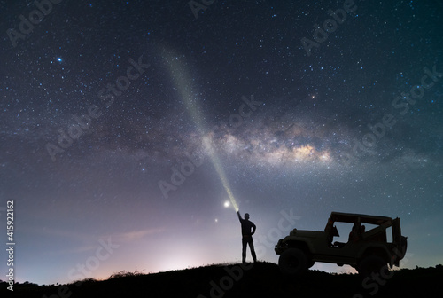 the car over the beautiful, wide blue night sky with stars and Milky way galaxy Fotobehang