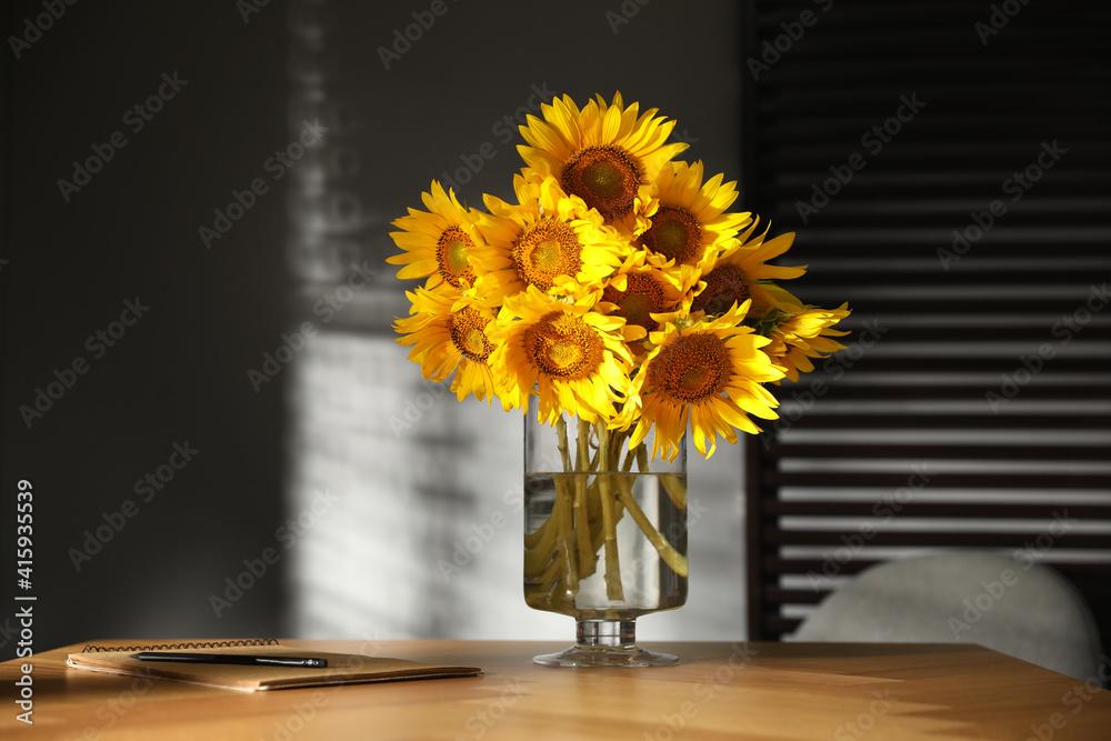 Fototapeta Bouquet of beautiful sunflowers on table in room
