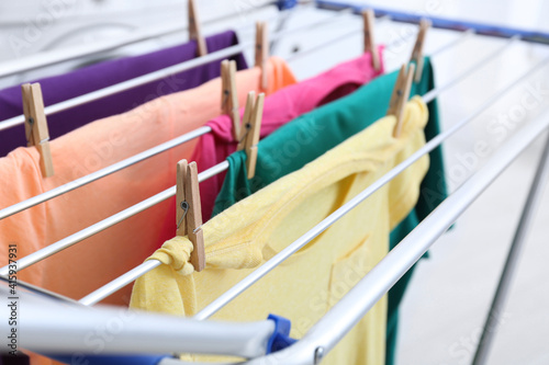Fototapeta Clean laundry hanging on drying rack indoors, closeup obraz