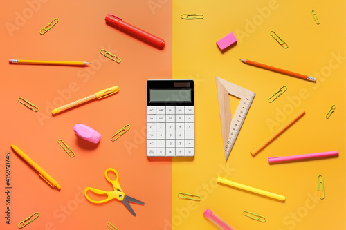 Modern calculator and stationery on color background © Pixel-Shot