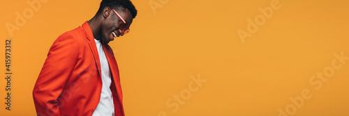 Obraz na plátně Handsome african fashion model on orange background