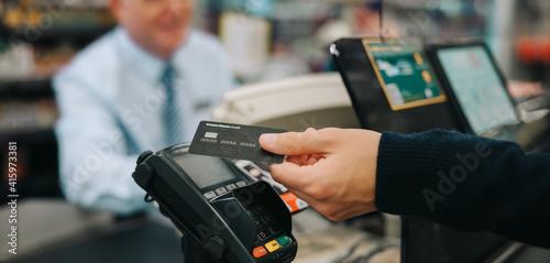 Fotografie, Obraz Contactless payment at supermarket