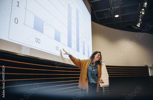 Female speaker giving presentation in a seminar