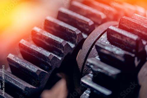 Fototapeta Large cog wheels in motor machine gear box, Industrial background obraz
