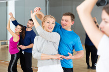 Attractive Mature Blonde Dancing Slow Ballroom Dance In Pair During Group Training In Dance Hall