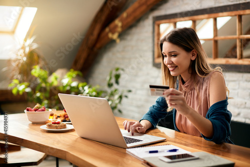 Obraz Young happy woman online shopping at home. - fototapety do salonu