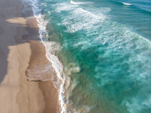 Aerial View Of Person Walking Along Clear Ocean Beach Indian Ocean In Ponta Do Ouro, Mozambique