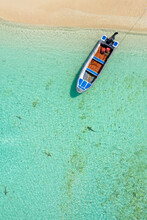 Aerial View Of Sharks Swimming Alongside A Small Boat At Aldabra Atoll, Seychelles.