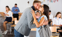 Young Woman Meeting Her Male Friend With Kiss In Lecture Hall Before Training Course..
