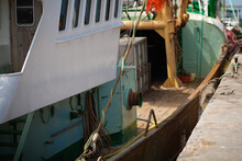 Fishing Boat Stands In Port, Maritime Transport Theme . High Quality Photo