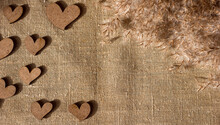 Decorative Wooden Hearts And Dried Reeds On Burlap Canvas Background, Love Theme And Valentine's Day, Copy Space For Text