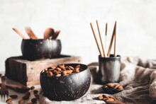 Coconut Bowls Containing Almonds. Healthy Food