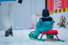 Kid Carried In A Sled
