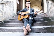 Male Street Musician.  Art And Music Concept. Selective Focus  On Bare Feet