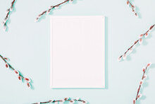 Spring Flower Composition. Photo Frame, Willow Twigs On Mint Background. Flat Lay, Top View, Copy Space