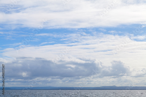 Sea water under cloudy blue sky on a daytime © evannovostro