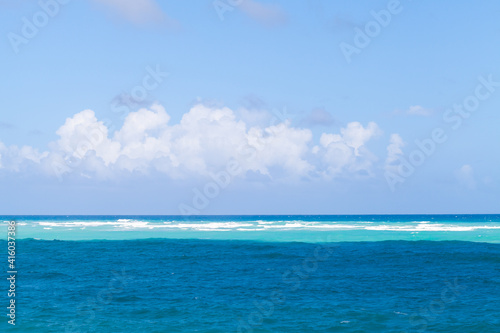 Caribbean Sea water under cloudy blue sky on a sunny day © evannovostro