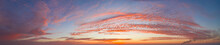 Intense Dramatic Panoramic Sunset With Cirrus Clouds Illuminated By Red Sunbeams