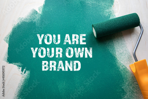 Foto You Are Your Own Brand. Green painted wooden background