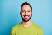 Photo Of Happy Charming Young Bearded Guy Wear Glasses Green T-shirt Isolated On Pastel Blue Color Background