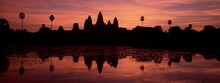 Silhouette And Reflections Of The Temple Of Angkor Wat At Sunrise, UNESCO World Heritage Site, Angkor, Siem Reap Province, Cambodia, Indochina, Southeast Asia, Asia