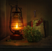 A Burning Kerosene Lamp Illuminates A Hydrangea Flower, A Key On The Wall, And A Book With A Rowan Branch. Vintage. Retro.