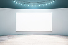 Spacious Empty Hall Room With Blank White Poster On Light Wall, Parquet Floor And Led Light On Top. Mockup