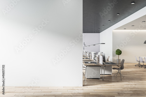 Obraz Blank light grey wall in sunny open space office with wooden floor and eco style furniture. Mockup - fototapety do salonu