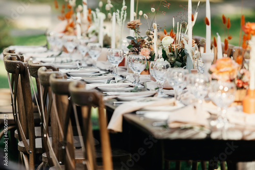Fotografie, Tablou Boho wedding table for guests at bouquet after wedding ceremony and photo for ma