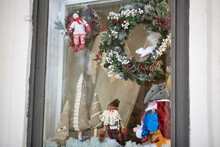 A Shop Window Displaying New Year's Wreaths With Squirrel And Parsley, Three Handmade Linen Christmas Trees With Lace, Santa Claus And Two Smart Mice.