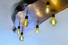 Designer Chandelier Made Of Several LED Lamps In Interior Of Cafe.