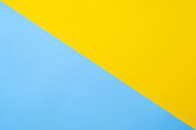 Yellow-blue Background Bisected Vertically. Diagonal Blue And Yellow Sheet Of Paper
