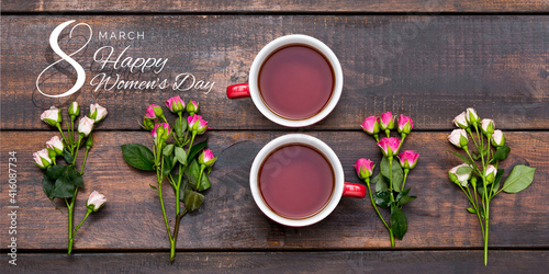 Composition of two cups of tea in shape of number eight 8 with beautiful flowers roses isolated on wooden table. Postcard for Women's Day March 8th. Concept of holidays, greetings. Copy space for ad © master1305