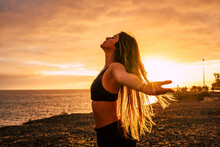 Fitness Happy And Free Young Woman Enjoy The Sunset After The Sport Workout Activity Session Taking Breathe - Body Health Care People Concept With Beautiful Woman Outdoor Opening Arms