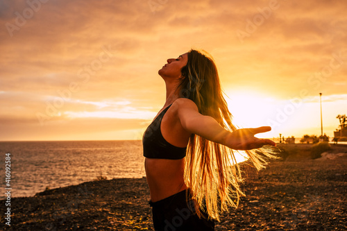Fitness happy and free young woman enjoy the sunset after the sport workout acti Fototapeta