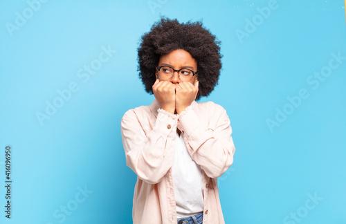 Slika na platnu looking worried, anxious, stressed and afraid, biting fingernails and looking t