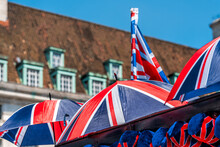 Colorful Union Jack Flag Umbrellas Closeup In Souvenir Store Shop In London, United Kingdom Bokeh Background Of Historic Building In Downtown