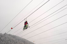 Sky Bike In The Winter Mountains.