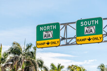Florida State Road Highway Street A1A To North Or South Ramp Only Direction Signs In Miami Dade County With Palm Trees And Blue Sky