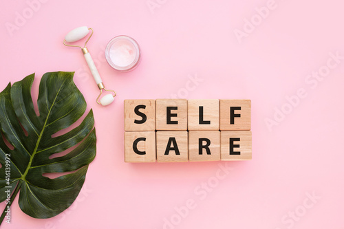 Fotografie, Obraz SELF CARE - text on wooden cubes on pink background