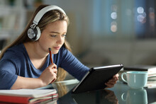 Student E-learning With Tablet And Headphones