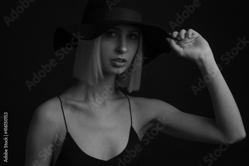 Fototapety, obrazy: Black and white portrait blondes on black background in a hat and Tank Top With Thin Straps