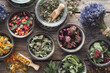 canvas print picture - Bowls and jars of dry medicinal herbs. Healing herbs assortment, top view. Alternative medicine.