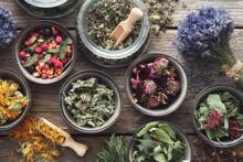 Bowls And Jars Of Dry Medicinal Herbs. Healing Herbs Assortment, Top View. Alternative Medicine.