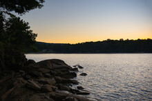 A Rocky Shoreline At Lake Jocassee, South Carolina At Sunset
