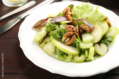 Delicious fresh celery salad on wooden table, closeup