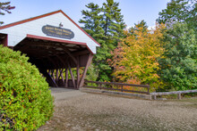 Covered Bridge With Red Roof In Autumn